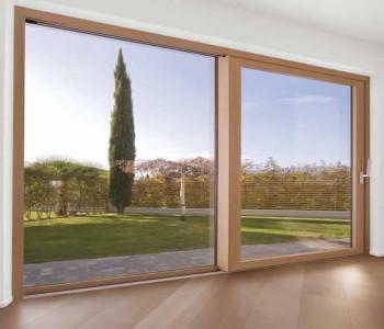 Finstral_Porta-finestra alzante scorrevole legno-PVC